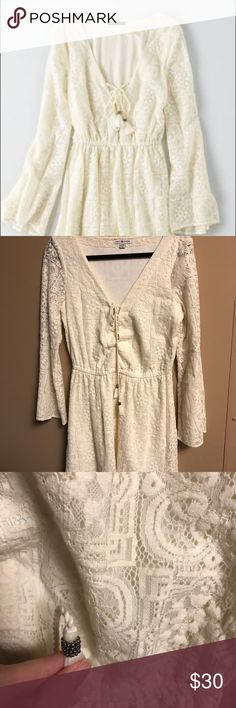 AE Trumpet Sleeve Dress A boho-hippie insipred dress awesome for a perfectly styled summer day! Trumpet sleeves, cream/white lace overlay, and lace up front with a pair of tassels. Could this dress be any more perfect? Size is medium and brand is American Eagle. Tag is marked to prevent returns to store. American Eagle Outfitters Dresses Mini