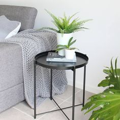 T•H•R•I•F•T•Y  You don't have to spend a truckload of money to refresh an area of your home. This side table, vase and fern were from @ikea_australia, the cushion was on sale at @tkmaxxau, the book, throw, and orchid & vase were given to me, and the leaves were out of the garden. All up this look (excluding the lounge) cost about $60! Happy days! Orchid Vase, Fern, Ikea, Cushions, Lounge, Australia, Leaves, Money, Living Room
