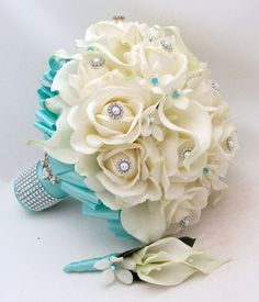Stephanotis Roses Calla Lily Tiffany Blue Ribbon with coordinating Groom's Boutonniere. Follow us @SIGNATUREBRIDE on Twitter and on FACEBOOK @ SIGNATURE BRIDE MAGAZINE