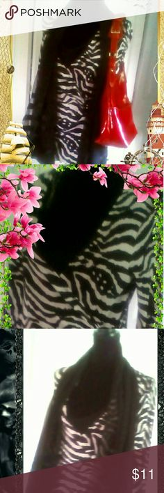 Zebra print V--Neck Blouse. (Final Sale) Zebra print V-NECK Blouse with side black buckle and inner black lining to accent the blouse. Tops Blouses
