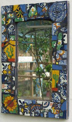 Mosaic Garden Mirror.  Broken Mexican tiles and black grout.