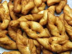 Danish Klejner Recipe ( Danish Twists)  Yield:  about 8 dozen   1 cup softened butter (or margarine)  1 cup sugar  2 eggs ( I sometimes use 3 eggs)  1 tsp vanilla  1 cup milk  5 cups flour (approx)  3 tsp baking powder  1 tsp salt  Vegetable or peanut oil for deep-frying