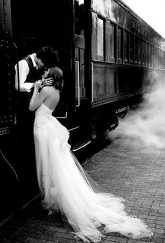 vintage romance romantic couple kiss good bye as he is about to board a train