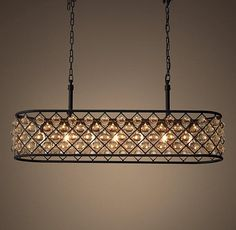 Lighting - The Spencer lighting collection's crystal glass spheres hang like gems within its iron grid.
