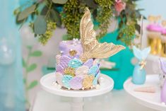 The cake at this Under the Sea Bubble Guppies 1st Birthday Partyis stunning! Love the gold mermaid tail! See more party ideas and share yours at CatchMyParty.com #catchmyparty #mermaidbirthdayparty #undertheseabirthdayparty #girl1stbirthdayparty #mermaidcake