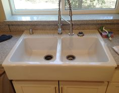"""I was really excited to use a Domsjo double bowl """"farmhouse"""" style kitchen sink in our new kitchen. Although it comes with one hole pre-drilled in the center for a faucet, the California Plumbing Code requires an air gap to be installed. The purpose of these devices to to make sure water will not back [&hellip"""