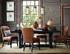 Check out this new Traditional Dining Table and Chairs from Williams-Sonoma.  Barbara Wirth Art really likes how the dark painted wall, with interesting molding designs, set off the pictures.  What a lovely dining room.