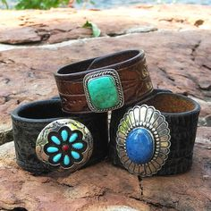 This leather cuff bracelet was created from a reconditioned, vintage leather belt full of well-worn character. We have repurposed an old pawn piece to be the focal point of the bracelet. The old pawn piece was originally a mans sterling silver ring created by an unidentified Navajo. The ring was not signed and I believe it was created in the mid 1900s. The hefty, square turquoise cabachon is a stunning aqua green color with subtle matrix inclusions. It sets in a plain bezel surrounded by a…