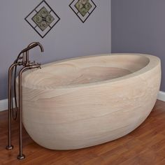 8 Stunning Examples Of Bathtubs Made From Solid Stone // This bathtub is handcrafted from a solid block of natural sandstone making every one unique.