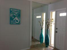 Fung shui home entrance Feng shui home entrance #vase #flowers #mirror #mermaids #welcome