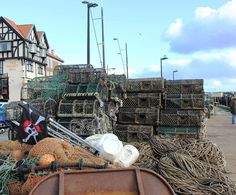Fishing gear on the quay #pots #crabpots #lines #doors #dans #markers #flag #net #jollyroger #scullandcrossbones #fishinggear #crabbing #fishing #quayside #harbour #scarborough #scarboroughharbour #yorkshirecoast #northyorkshire #instafish #instadaily #instaphoto #instagood #instagram #picoftheday #dailyphoto