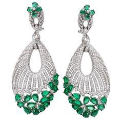 18K White Gold, 5.46CT White Diamonds, 18.62CT Emeralds