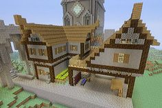 Medieval house with a workshop underneath. Minecraft xbox360. Adapted from someone's design on the computer version. AnomalousSpark.