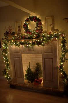Christmas Mantle: Garland to the floor on both sides, wreath, frames on each side.