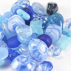 24020  Czech Blue Mixed Bead Collection, 50+/-  Enjoy the luscious array of blue shades included with our collection.  All even counts of fine Czech pressed glass, this mix is hand assembled and there are no odd beads.  Find multiple shapes such as butterflies, cubes, drops and hearts.  With multiple finishes included, these beads are sure to add interest to your creations.