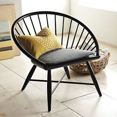 I love the look of this chair...like someone took a regular chair, tried to squish it flat, and only partially succeeded. Now, where to put it? Hmm...