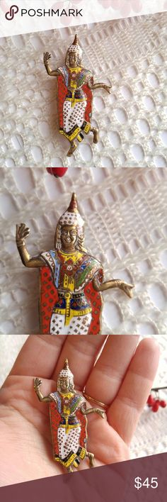 Vintage Siam Dancer brooch! Enamel gold tone This really cool vintage brooch is made of weighty metal with colorful enamel. It is shaped like a lively Siam Dancer. The back is stamped but the stamp is quite worn down, I think it may say Made in Siam but it's hard to read. It is in great shape with some normal surface wear. From a smoke free home :)  STARF8588siam888 Vintage Jewelry Brooches