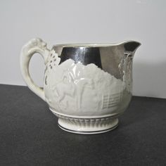 Obviously gilding the lily. Vintage Wedgwood D'ye ken John Peel Cream Pitcher with platinum overlay.