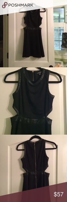 Double Zero dress. Double Zero black dress with black leather around cutouts. Gold zipper down back. Really pretty dress. Sad to see it go but its too small for me now. Only worn twice so basically perfect condition. Double Zero Dresses
