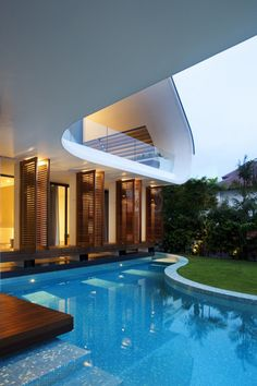 Shuttered windows open at poolside, plus cool overlook balcony (Aamer Architects)