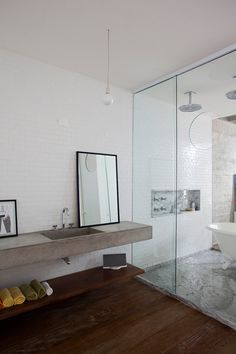 concrete bench top and timber shelf, white subways, marble shower and nook