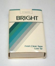"""Copyright 1983 by R.J. Reynolds Tobacco Co. Bright Cigarettes brand miniature matchbox pack. American Ace by Universal Match Corp Greensboro. """"Enjoy Bright"""" """"Fresh Clean Taste"""" No matches."""