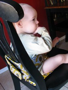 The Anywhere Chair turns a regular chair into a high chair. It rolls up fit in a diaper bag, and is machine washable.