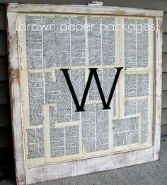 Old book pages, a monogram and an old window sash.