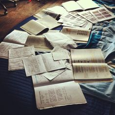 this is normally what my bed looks like when im writing from notes...