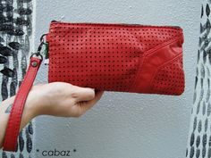 Pochette, en cuir rouge perforé via Cabazdesign. Click on the image to see more!