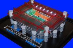 San Siro Stadia Model - Inter Milan FC @ www.sportsstadiaart.co.uk  HAND MADE MODEL WITH WORKING FLOODLIGHTS OF THE SAN SIRO STADIUM, HOME OF INTER MILAN FC. Each model comes on a black wooden frame with a clear plastic display cover. Lights are operated via a slide switch on the underside of the model. Lights operated by 3x AAA batteries(included) Model measures 23.5cm x 21.5cm. Click on the Personalise tab above to add a name or message on the stadium model.