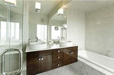 Small bathrooms can appear more airy -floating vanity-sparkling tiles- glass cabin shower
