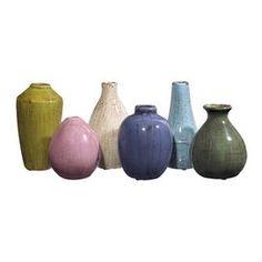 Six Tuscan-style ceramic vases.Product: 6 Piece vase set   Construction Material: Ceramic    Color: Multi    Features:   Different shapes and glaze colors  Subdued tones of blues, grays, reds and browns      Dimensions:    Small: 4.25 H x 3.5 Diameter       Large: 6.25 H x 3.75 Diameter