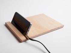 Groove Tablet is a minimalist design created by England-based designer Bee9. A Bee9 Tablet with a 9.5mm groove cut at an angle to comfortably hold most most smart phones and tablets. (2)