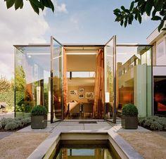 Modern tall glass building extension designed by Architektenbureau van Der Heuvel