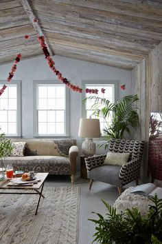 Anthropologie shoot in the first home we designed! Wood ceilings and walls. Garland makes the day.