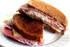 Classic reuben sandwich with corned beef, dark rye bread, Swiss cheese, sauerkraut, with Russian dressing - grilled.