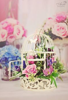 Vintage style birdcage in pinks and purples