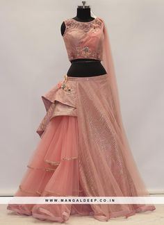 This festive season look stunning and classic with this beguiling pink color designer lehenga choli. This function wear net lehenga choli is decorated with fancy embroidery work. The outfit comes alon. Indian Wedding Gowns, Indian Bridal Outfits, Indian Gowns Dresses, Net Dresses, Net Lehenga, Lehenga Gown, Lehenga Choli Wedding, Saree, Designer Party Wear Dresses