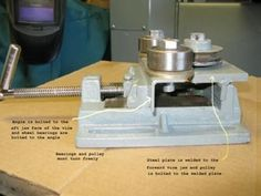 Rod Roller by Joe Schimka -- Homemade rod roller constructed from surplus steel stock, bearings, a pulley, threaded rod, nuts, and bolts. http://www.homemadetools.net/homemade-rod-roller-2