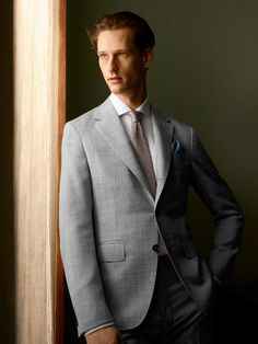 fc75c70eb80f24 A man's #suit serves as a vehicle for communicating identity. A tailored  silhouette in