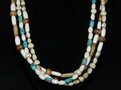 Check out this item in my Etsy shop https://www.etsy.com/listing/274301854/three-strand-natural-bone-turquoise