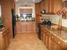 what color appliances with oak cainets and black countertops | favorite granite countertop (flooring, color, sink, appliance ...