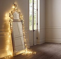 Lights draped around a mirror! Ideas for christmas lights decoration in the bedroom | DesignFolio
