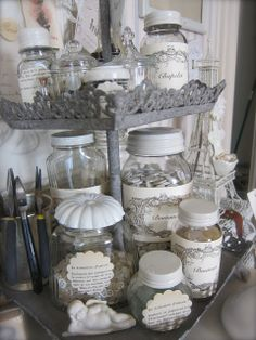 Repurposed jars - lids painted white, beautiful labels. From:Petite Michelle Louise Studio