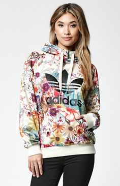 "adidas collaborates with Brazil's The FARM Company to present the colorful Farm Confete Trefoil Pullover Hoodie. Adding the flair of Rio de Janeiro to your collection, this pullover hoodie is definied by its allover floral print, large Trefoil logo and wordmark on front, soft French terry fabrication, plus an oversized hood. Style this hoodie with the matching leggings and your favorite pair of kicks.   	26"" in length (size Medium) 	Pullover hoodie 	Multicolored print throughout 	Rubber..."