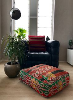 Moroccan Kilim pouf made from vintage kilim rugs.  60 x 60 x 20 cm/ 24 x 24 x 8 inch.  100% wool and handmade.  Each pouf is Unique, with only one available.  Pouf comes unstuffed (to cut shipping costs). They are easily filled with various items, like fabrics, newspaper, beats and plastic bags.