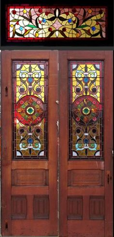 Stained glass pine doors with matching transom.