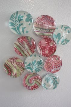 Glass Fabric/Paper Magnets:  Mod Podge flat side of glass disk, press gently onto fabric or scrapbook paper, let dry, trace around disk and cut just inside the line, MP the outside surface of the fabric/paper, let dry, glue magnet on.