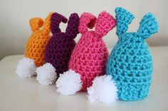 Free Pattern: Crochet Bunny Egg Cozy for Easter - Would be cute over those big Creme Eggs.  Also with eyes a bunny nose and a few wiskers.